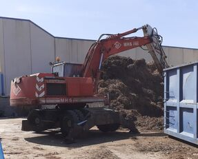 O&K MH 6 wheel excavator